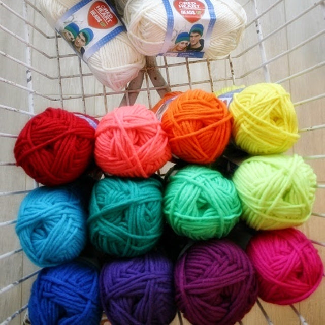 Rainbow of yarn balls in basket, Susan Carlson of Felted Button | Colorful Crochet Patterns
