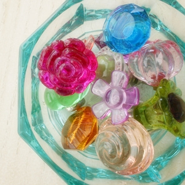 Colorful glass knobs for dressers in glass jar, by Susan Carlson of Felted Button | Colorful Crochet Patterns