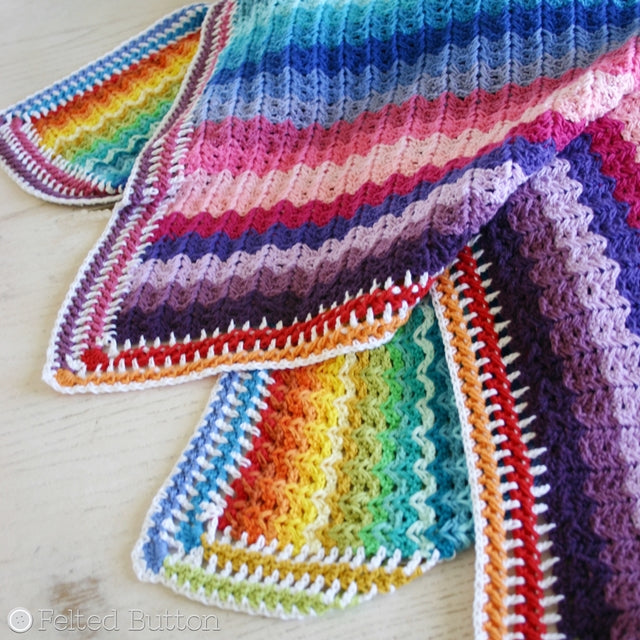 Rainbow striped and colorful textured crochet blanket, Illuminations Blanket free crochet pattern by Susan Carlson | Felted Button | Colorful Crochet Patterns