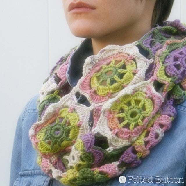 Pretty girl wearing pink, yellow, purple and green lacey crochet cowl, Infinity Blossom Cowl by Susan Carlson of Felted Button | Colorful Crochet Patterns