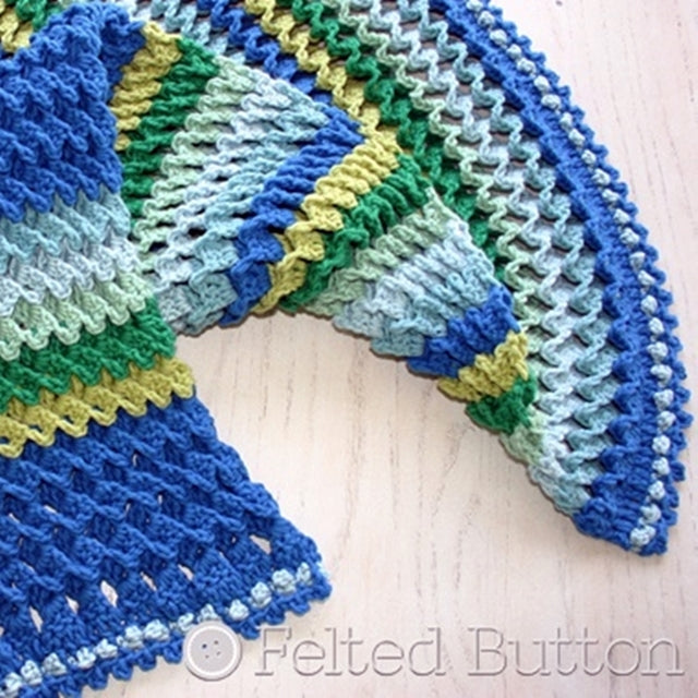 Blues and greens in textured and windowed crochet pattern, 3D, Irish Sea Blanket or crochet throw pattern by Susan Carlson of Felted Button | Colorful Crochet Patterns