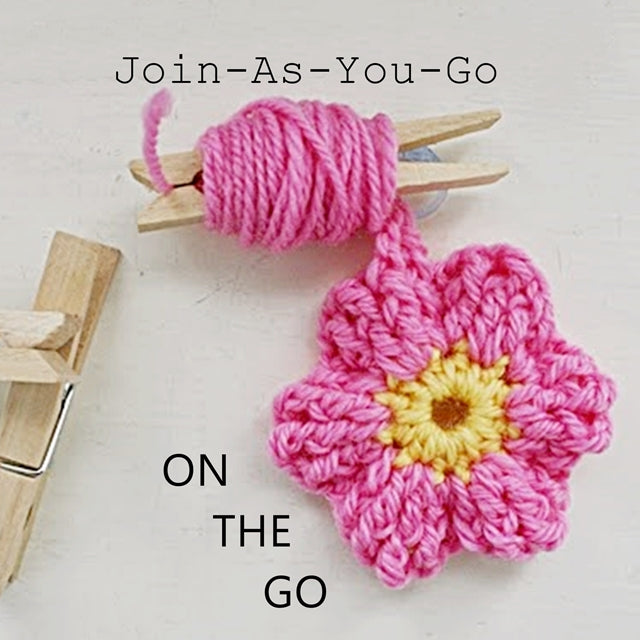 Join as you go on the go, pink crochet flower with tail wrapped around clothespin, crochet tip or tutorial by Susan Carlson of Felted Button | Colorful Crochet Patterns