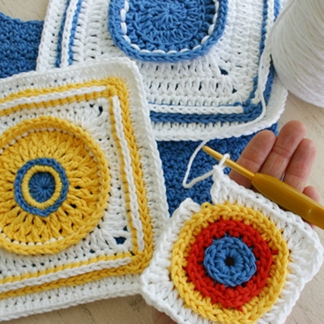 Crochet squares with colorful centers, designed by Susan Carlson of Felted Button | Colorful Crochet Patterns