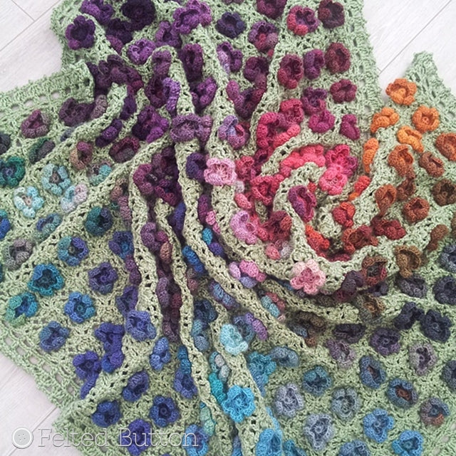 Monet's Garden Throw, crochet afghan pattern with colorful watercolor yarn in textured flowers and green trellis background, crochet pattern by Susan Carlson of Felted Button | Colorful Crochet Patterns