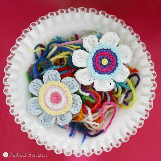 Small, 7 petaled crocheted flowers with slip stitching, crochet pattern Olivia's Flower by Susan Carlson of Felted Button | Colorful Crochet Patterns