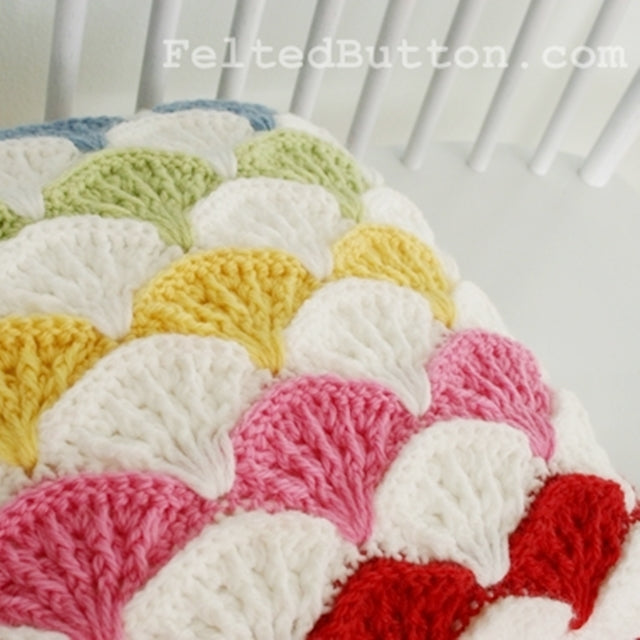Paintbrush pillow and afghan crochet pattern in rainbow by Susan Carlson of Felted Button | Colorful Crochet Patterns