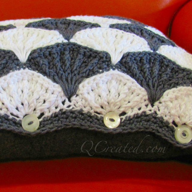 Black and white paintbrush crochet pattern on orange chair by Susan Carlson of Felted Button | Colorful Crochet Patterns