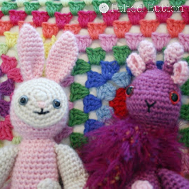 Amigurumi Bunny and giraffe in pink and purple against rainbow granny pillow background, Susan Carlson of Felted Button | Colorful Crochet Patterns
