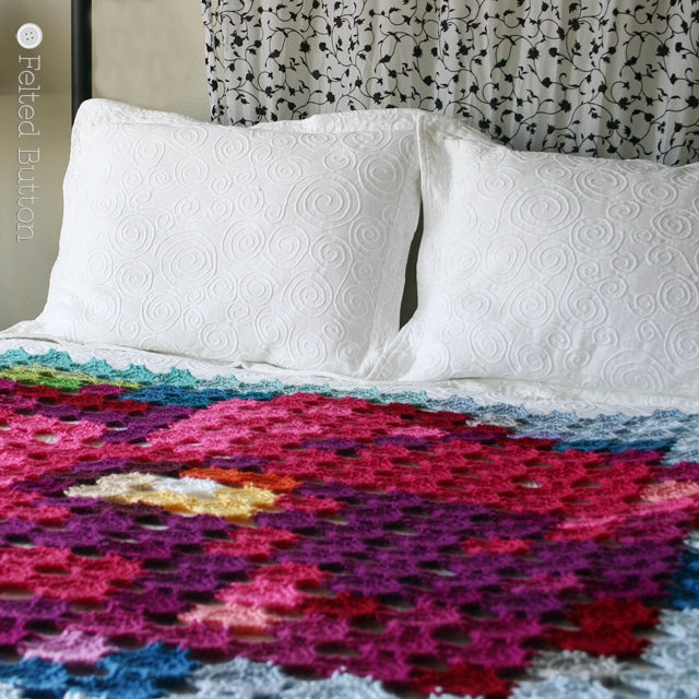 Pointillism Posie Blanket, crochet art blanket made with pixels or motifs that resembles large pink posie flower, crochet pattern by Susan Carlson of Felted Button | Colorful Crochet Patterns
