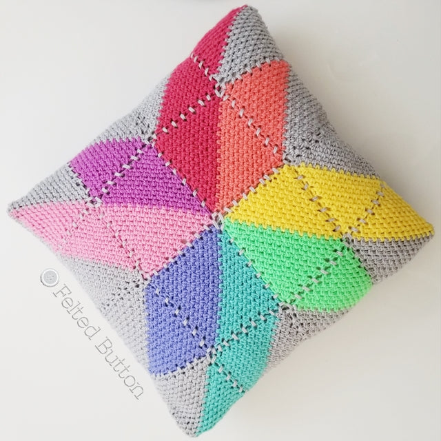 Prism Pillow | Crochet Pattern | Felted Button | rainbow of prism shaped squares crocheted on square pillow