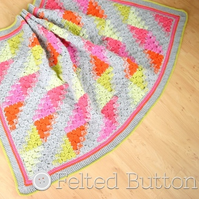 Puzzle Patch Blanket with half squares in C2C, corner to corner crochet stitch pattern in pinks, oranges, yellows and citrine, by Susan Carlson of Felted Button | Colorful Crochet Patterns