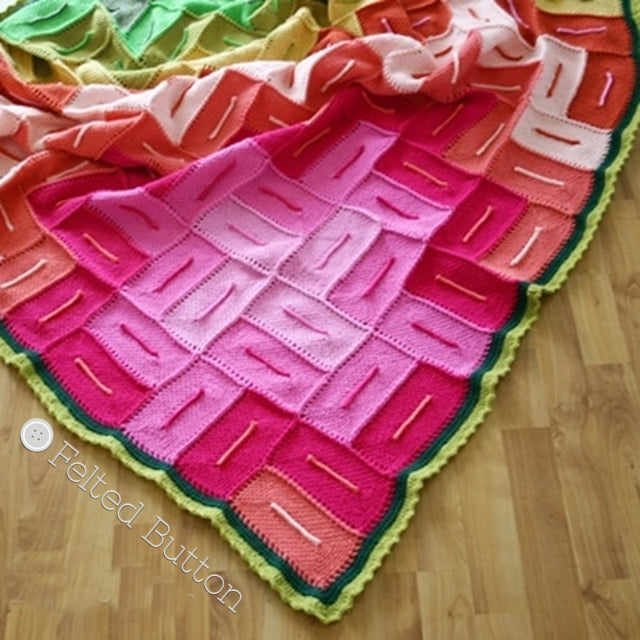 Graphic pink, green and orange crochet blanket in linen stitch resembling flower; Radiant Blanket by Susan Carlson | Felted Button | Colorful Crochet Patterns