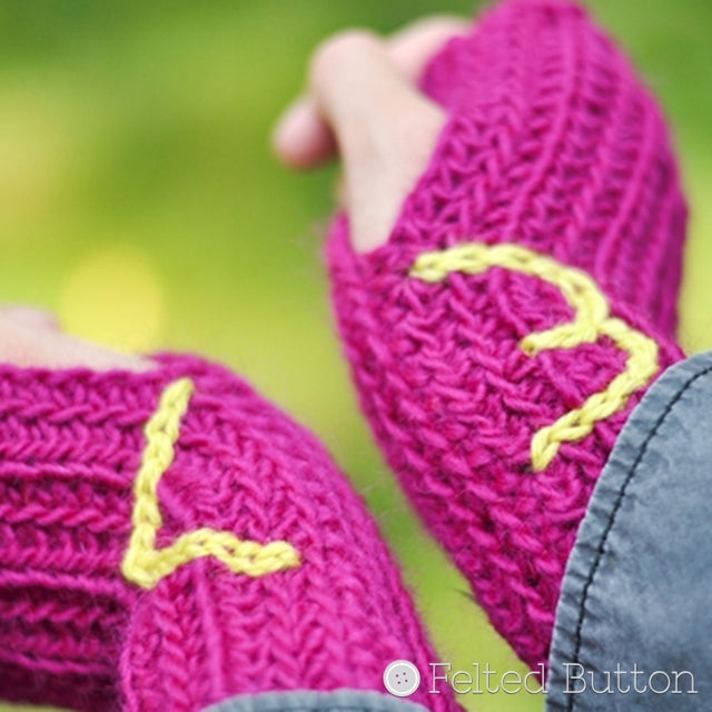 Pink ribbed wristwarmers with <3 at wrists, Ribbed Wristwarmers crochet pattern by Susan Carlson of Felted Button | Colorful Crochet Patterns