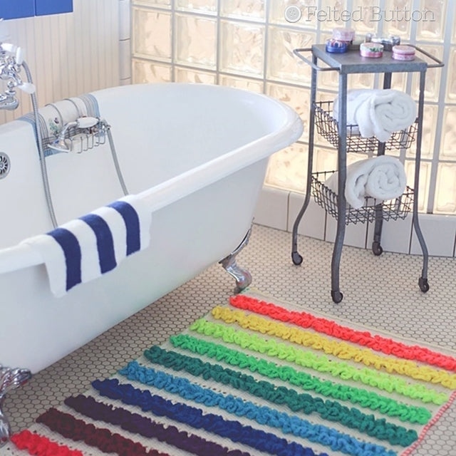 Colorful ruffled rainbow mat in front of white standing tub, Rainbow Ruffles Blanket crochet pattern by Susan Carlson of Felted Button | Colorful Crochet Patterns