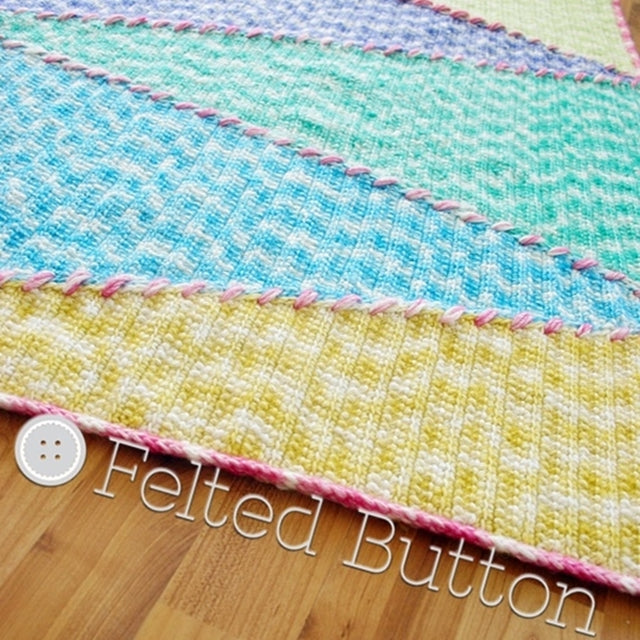 Sally Blanket, large colorful triangles in blue, green and yellow with pink stitching and border, crochet pattern by Susan Carlson of Felted Button | Colorful Crochet Patterns