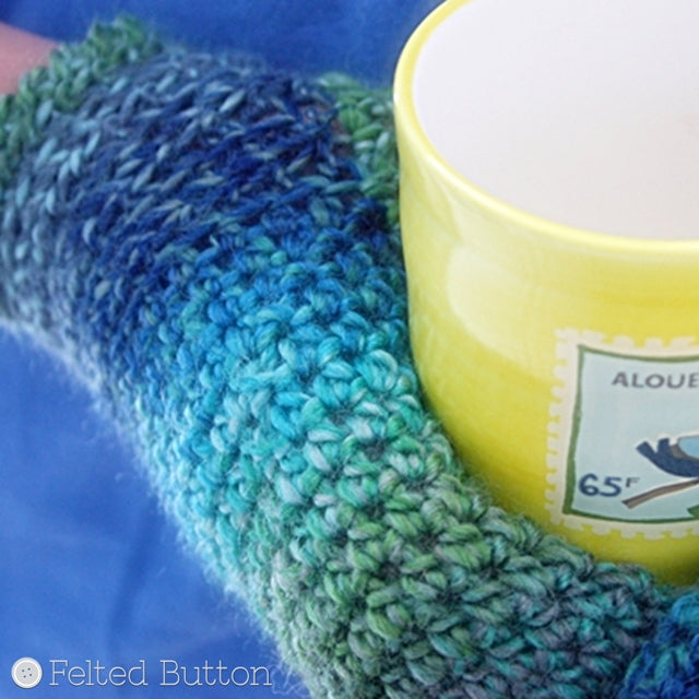 Green and blue mittens holding yellow mug, crochet pattern by Susan Carlson of Felted Button | Colorful Crochet Patterns