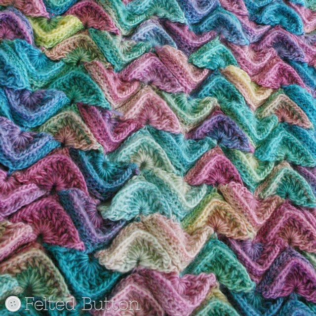 Multi-colored and textured scale shaped crochet motifs joined in blanket, made with Red Heart Unforgettable yarn in Candied color, Sea Song Blanket crochet throw or afghan pattern by Susan Carlson of Felted Button | Colorful Crochet Patterns