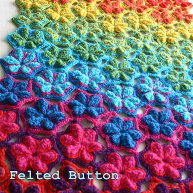 Star Fruit Blanket and Rug in rainbow crochet, textured with star shaped flowers or hexagons, crochet pattern designed by Susan Carlson of Felted Button | Colorful Crochet Patterns