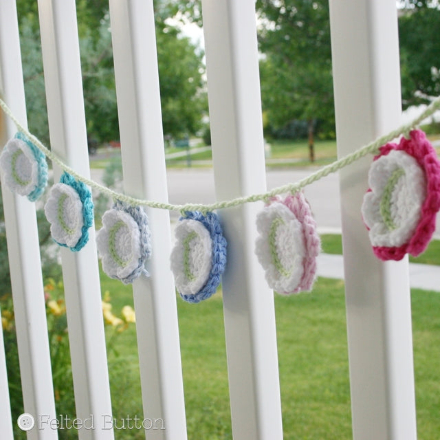 Cotton layered flowers with white center, bunting or garland hanging on banister, free crochet pattern by Susan Carlson of Felted Button | Colorful Crochet Patterns, Summer Flower Bunting