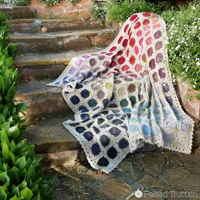 Sweven Throw, rainbow of swirls on neutral background crochet afghan made with Scheepjes Our Tribe, by Susan Carlson of Felted Button colorful crochet patterns
