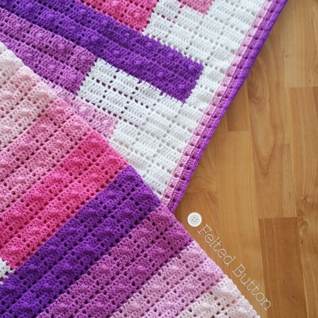Teetering Tower Blanket crochet pattern in pinks and purples, resembles stacked books on white background, crochet pattern by Susan Carlson of Felted Button | Colorful Crochet Patterns
