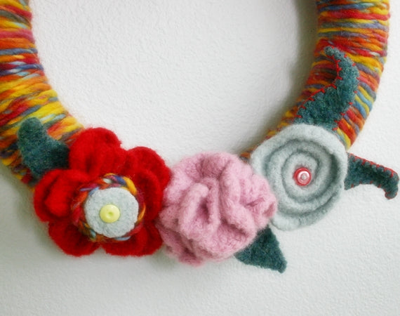 Colorful Felted yarn-wrapped wreath with felted flowers and buttons, by Susan Carlson of Felted Button | Colorful Crochet Patterns