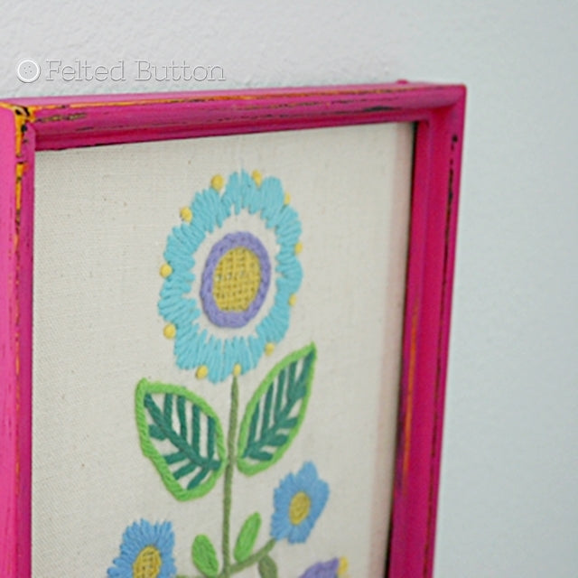 Pink framed simple vintage embroidery of flower, Susan Carlson of Felted Button | Colorful Crochet Patterns
