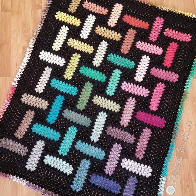 Rainbow and black modem rectangle granny square crocheted blanket with pom pom effing, crochet pattern by Susan Carlson of Felted Button Colorful crochet patterns