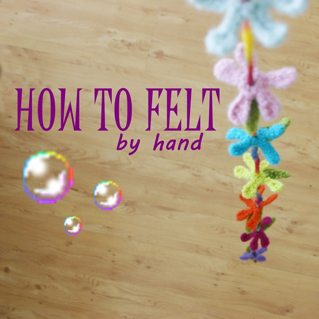 How to felt by hand, Wee Felted Blossoms hanging on string, hand-felted flowers in many colors, crochet tutorial or tip by Susan Carlson of Felted Button | Colorful Crochet Patterns