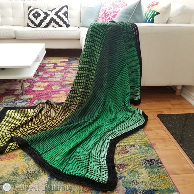 Green ombre crocheted blanket with black trim, made with interlocking crochet and Scheepjes Whirl yarn, free cricket pattern,  by Susan Carlson of Felted Button colorful crochet patterns