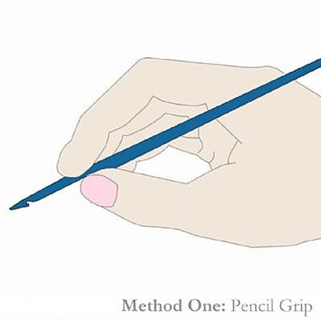 Image of hand holding crochet hook in pencil grip, Susan Carlson of Felted Button | Colorful Crochet Patterns