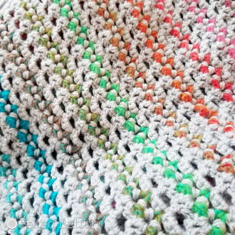 Elan Blanket crochet pattern designed by Susan Carlson of Felted Button | colorful crochet patterns | using Scheepjes River Washed and Scheepjes Colour Crafter