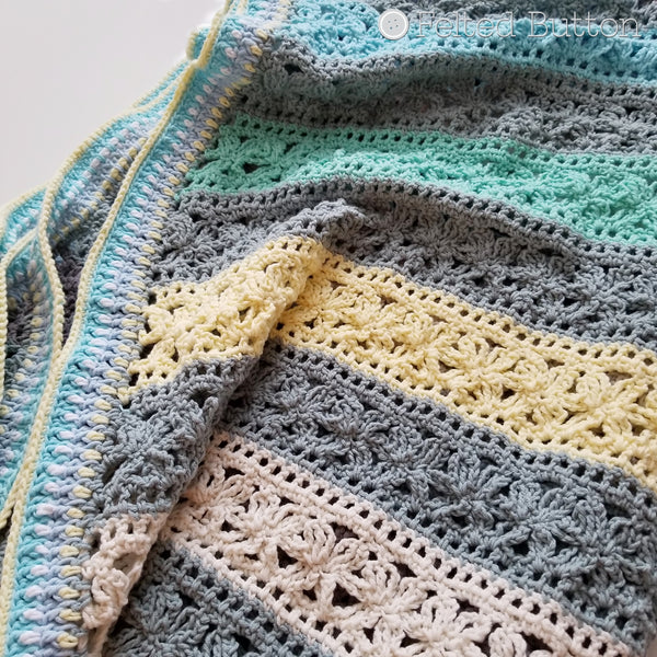 Under the Awning Blanket crochet pattern by Susan Carlson of Felted Button | Colorful Crochet Patterns | cabana striped cotton baby blanket throw or afghan in blues, yellows and grays