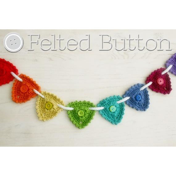Button Garland, Bunting, or hanging triangle ornaments with a button center for decorating home or nursery, a free crochet pattern by Susan Carlson of Felted Button