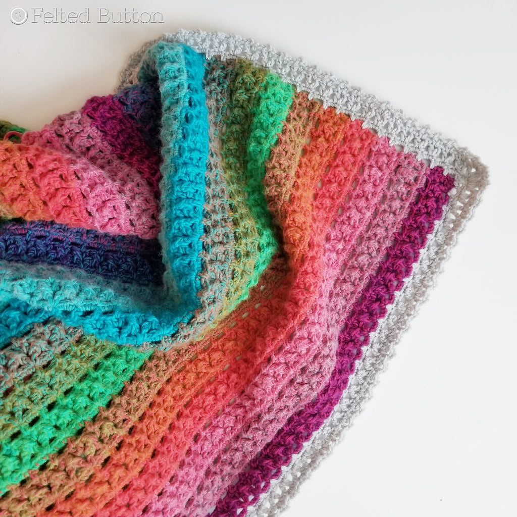 Elan Blanket crochet pattern, rainbow striped throw designed by Susan Carlson of Felted Button | Colorful crochet patterns | made using Scheepjes River Washed and Scheepjes Colour Crafter yarns