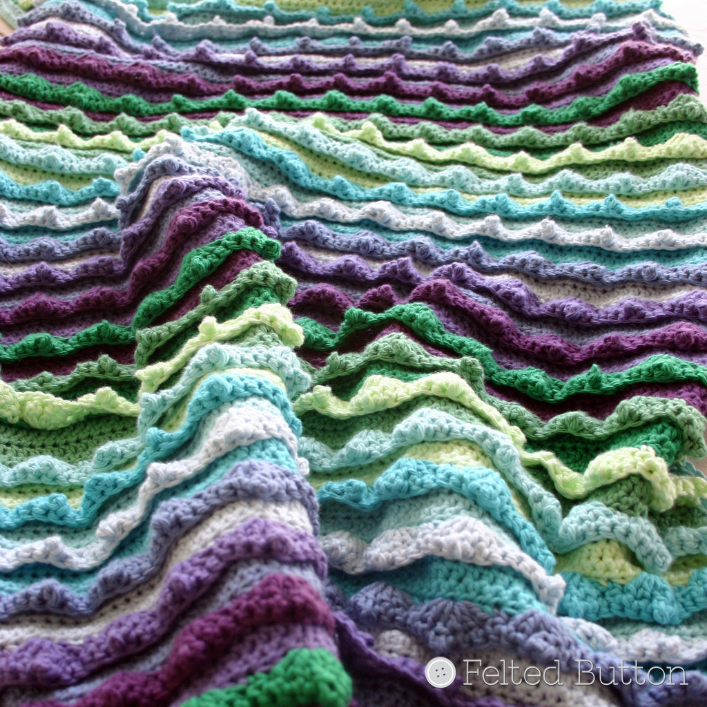 Textured, blue, green and purple blanket with crocheted waves, Eventide Blanket crochet pattern by Susan Carlson of Felted Button