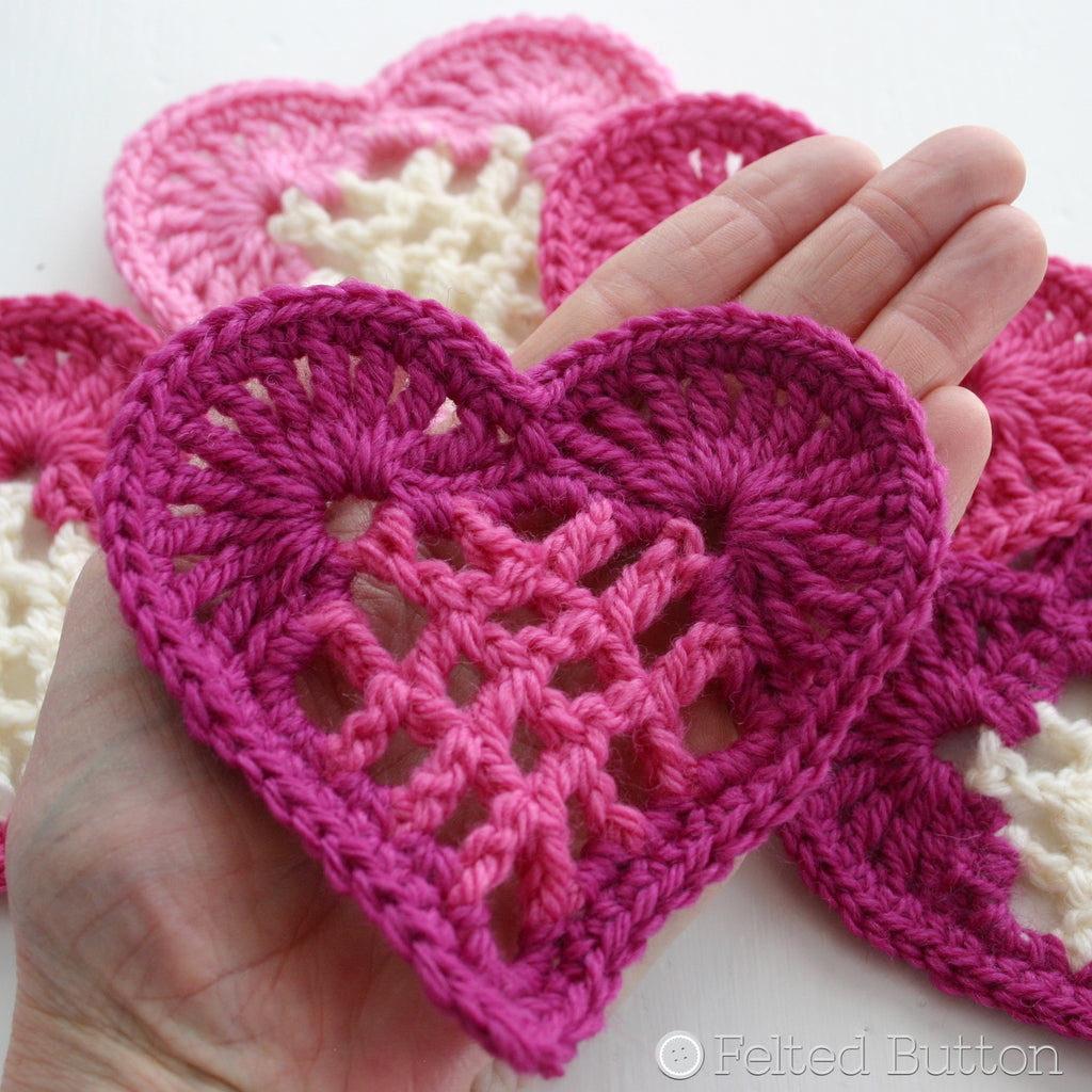 Pink crochet heart motifs with grid center, From the Heart Bunting, free crochet pattern by Susan Carlson of Felted Button
