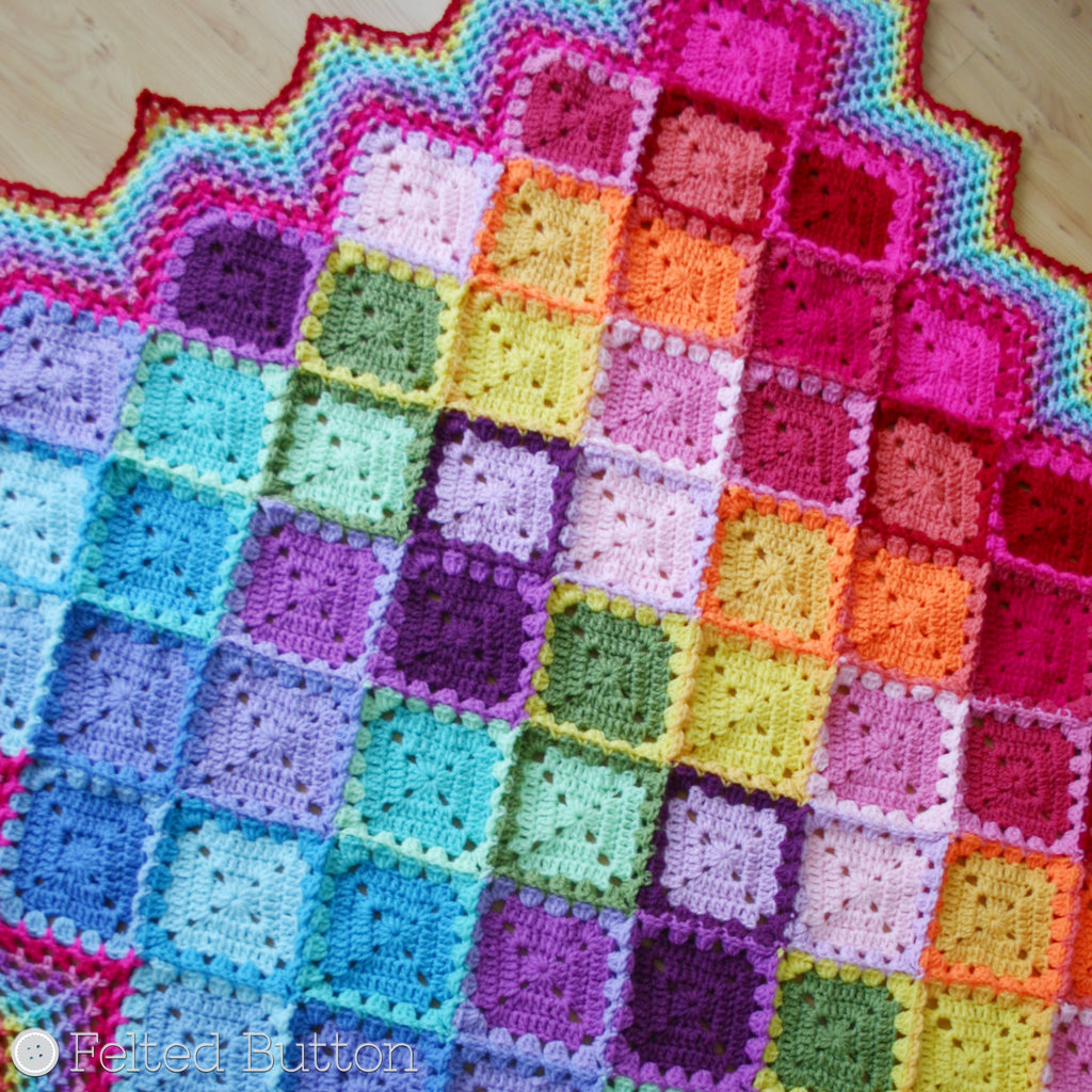 Happy Harlequin Blanket, free crochet pattern designed by Susan Carlson of Felted Button, made with Scheepjes Colour Crafter yarn, granny squares and colorful diamonds