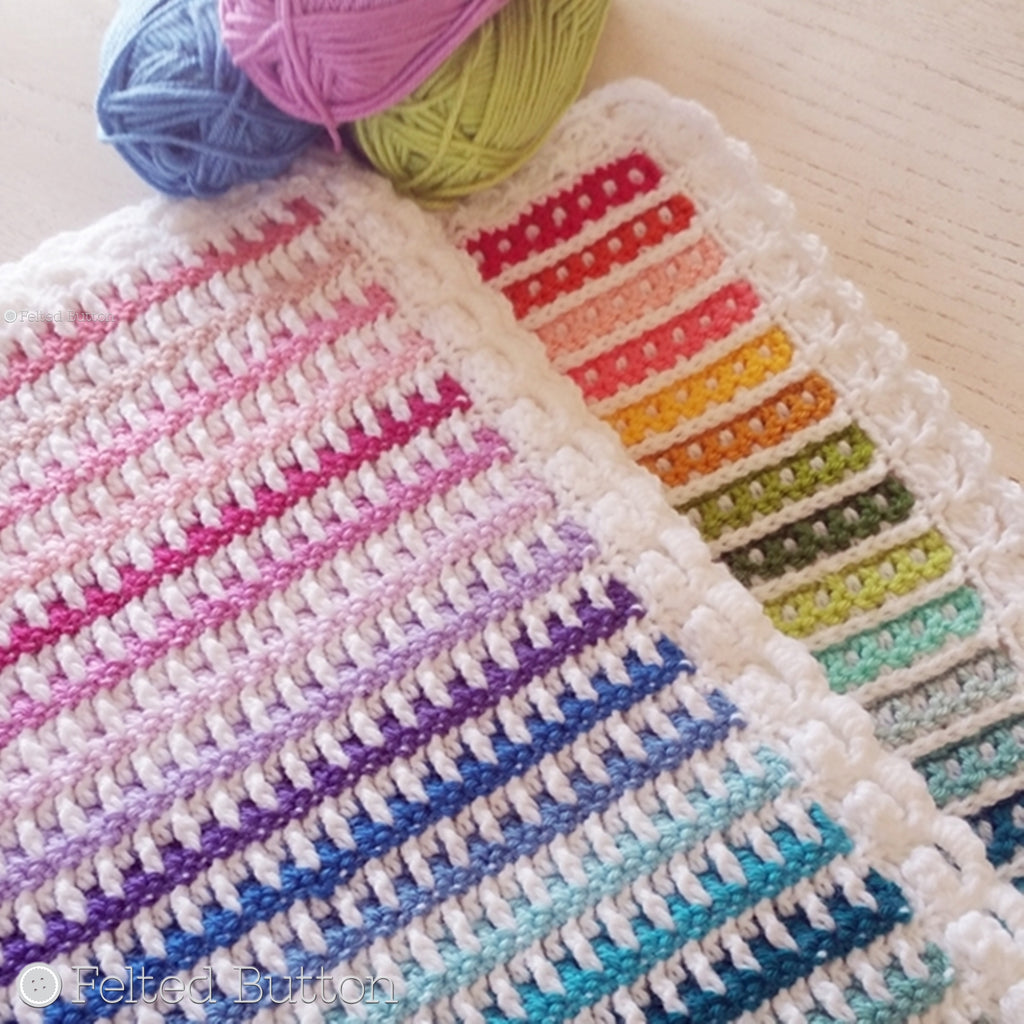 Rainbow striped and textured crochet blanket with white border and different texture on front and back, Janus Blanket by Susan Carlson of Felted Button, colorful crochet patterns