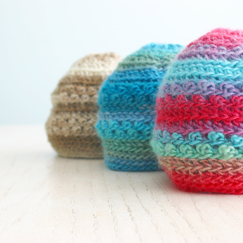 3 crochet baby hats in red/turquoise, turquoise/green and tan, Only Just Born Hat, crochet pattern for newborns by Susan Carlson of Felted Button