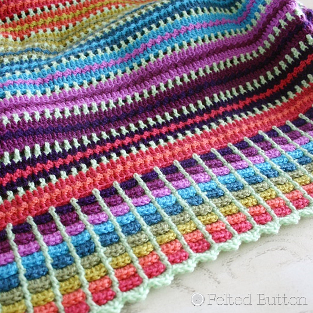Striped crochet blanket in rainbow colors, Skittles Blanket crochet afghan throw pattern by Susan Carlson of Felted Button