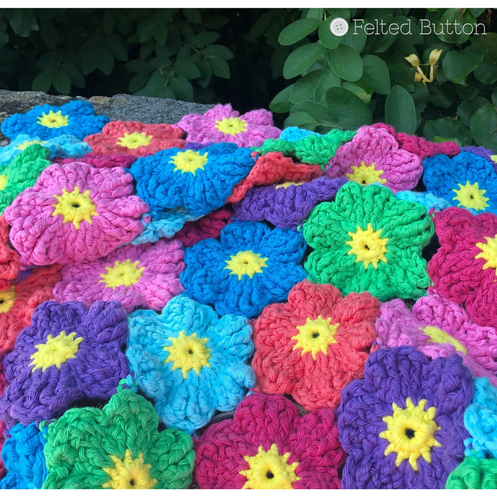 Textured and rainbow colored crochet flower blanket, Waikiki Wildflower Blanket, crochet pattern by Susan Carlson of Felted Button