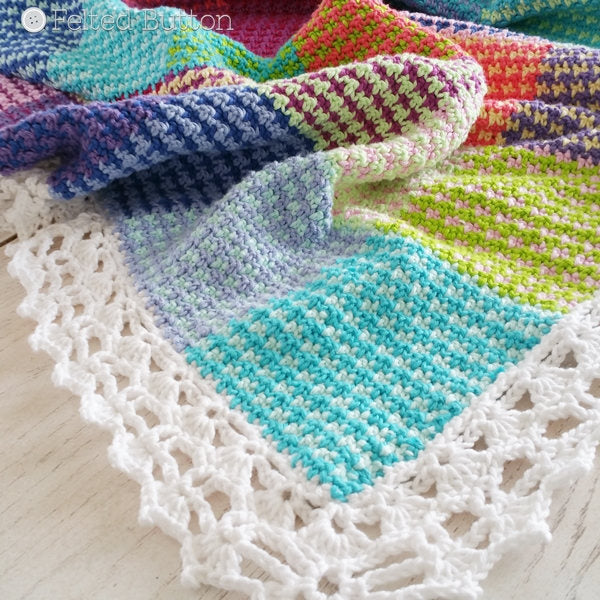 Rainbow patches crochet blanket with herringbone stitch and lace border, Washburn Blanket crochet afghan pattern by Susan Carlson of Felted Button