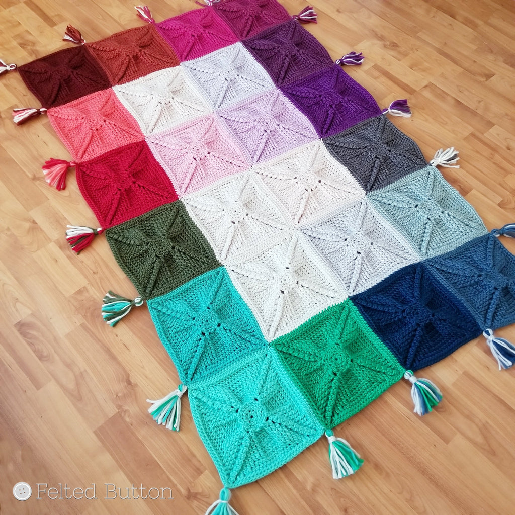 Asanas Blanket | Free Crochet Pattern | Felted Button, colorful granny square chunky blanket in a rainbow with loads of texture and tassels