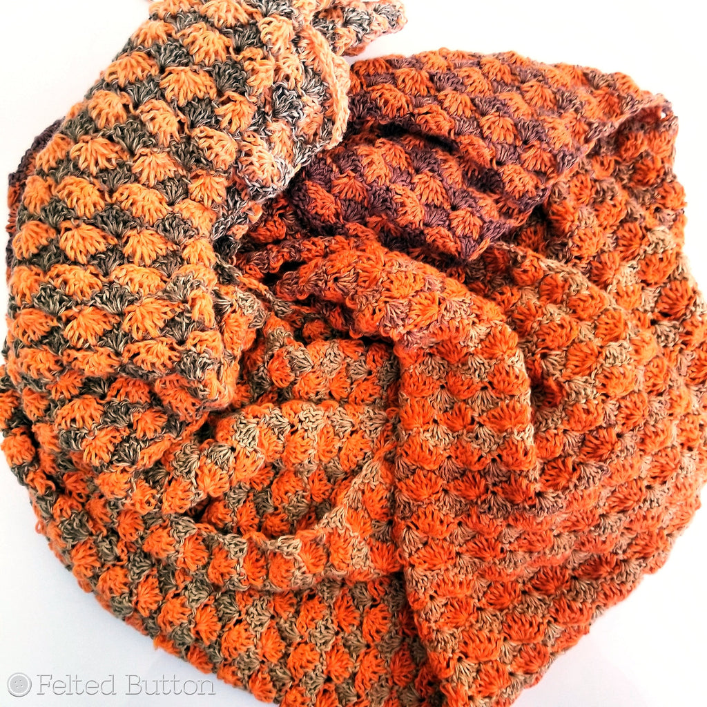 Orange and brown crochet shawl designed by Susan Carlson of Felted Button, Duo Shawl free crochet pattern
