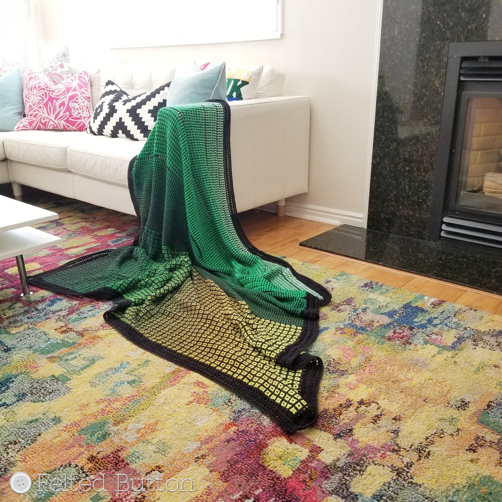 Green ombre blanket made with 2 cake of Scheepjes Whirl and interlocking crochet, Window to the Whirl crochet afghan pattern by Susan Carlson of Felted Button