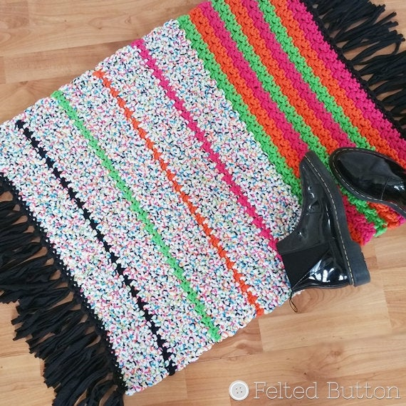 All Sorts Rug that looks like all-sorts candy colors, made with Scheepjes Nooodles t-shirt yarn, striped and fringed
