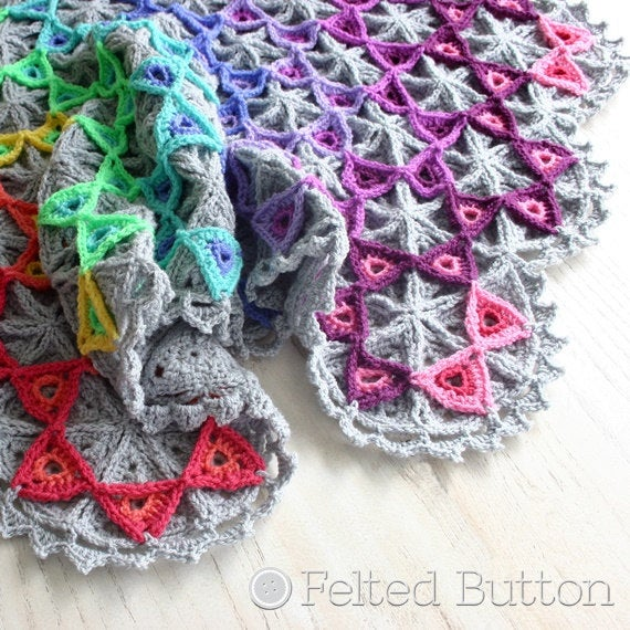 Colorful rainbow triangles on top of a gray base of triangles crochet blanket, Prism Blanket crochet afghan throw pattern by Susan Carlson of Felted Button
