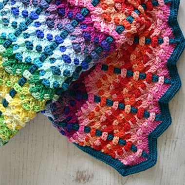 Rainbow of color baby afghan by Susan Carlson of Felted Button, colorful crochet patterns for Chromatic Cobbles Blanket, textured crochet afghan
