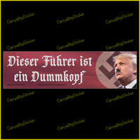 Bumper sticker or magnetic bumper sticker says Dieser Fuhrer ist ein Dummkopf. Features photo of Trump with Hitler-type mustache and Swastika in background.